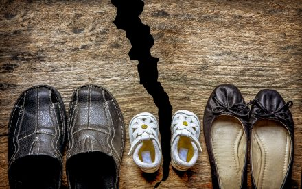 family shoes with a broken floor depicting a family split