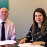 Roger Clayson from Laceys Solicitors sitting with Denise Cárdenas, Tradebe Inutec, Security Safety Health Environment and Quality Manager