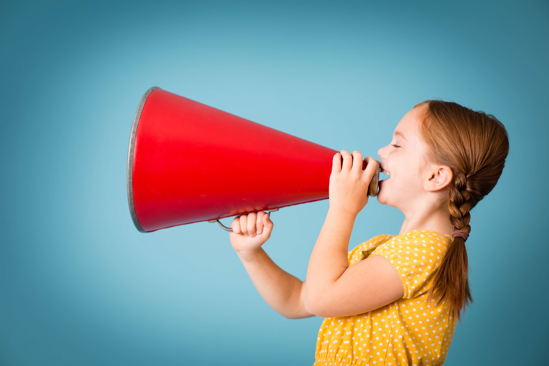 girl talking through a red horn