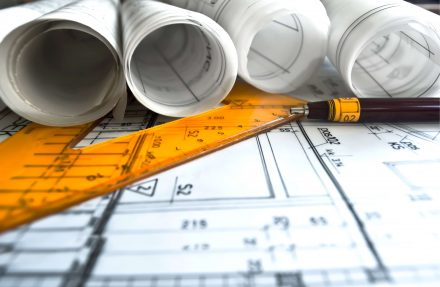 rolls of house plans on tracing paper