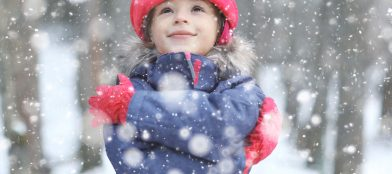 young girl feeling happy in the snow