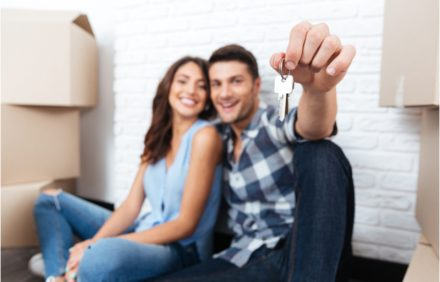 Young couple new homeowners with keys