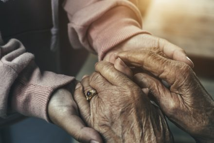 old and young hands holding