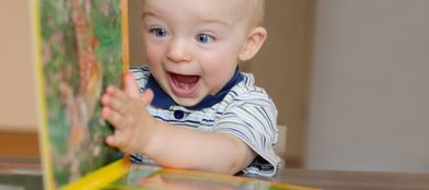 happy boy turning a book