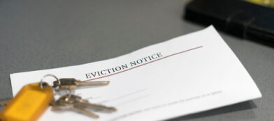 eviction notice paperwork with set of house keys