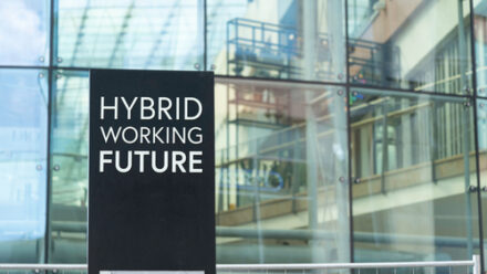 hybrid working future sign in front of an office