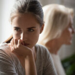 older adult disagreeing with parent